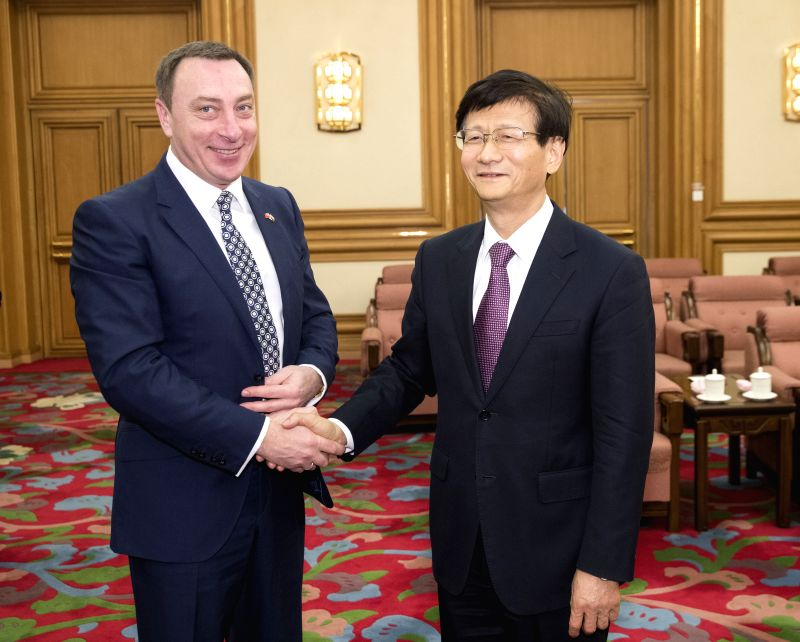 BEIJING, May 14, 2017 - Meng Jianzhu (R), head of the Commission for Political and Legal Affairs of the Communist Party of China (CPC) Central Committee, meets with Belarusian deputy director of the ...