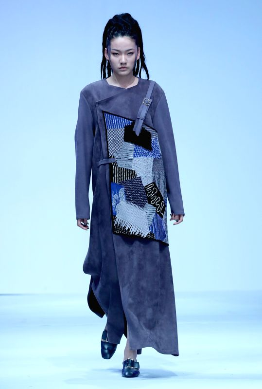 BEIJING, May 15, 2016 - A model presents a creation designed by graduates of Dalian Polytechnic University during the China Graduate Fashion Week in Beijing, capital of China, May 15, 2016.
