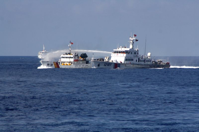 China Coast Guard ship Haijing 12101 (R) uses water cannons to expel Vietnam marine surveillance ship KN-763 which intruded into a Chinese company's work zone in ...