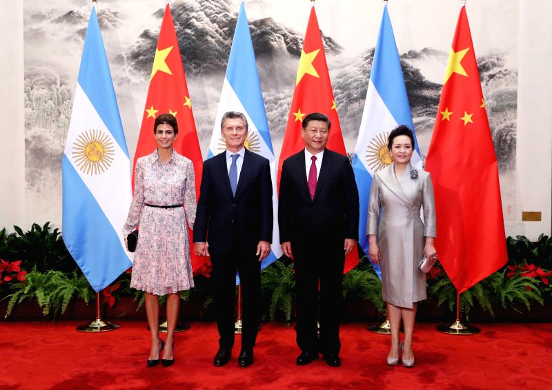 BEIJING, May 17, 2017 - Chinese President Xi Jinping (2nd R) and his wife Peng Liyuan (1st R) pose for a photo with Argentine President Mauricio Macri (2nd L) and his wife in Beijing, capital of ...