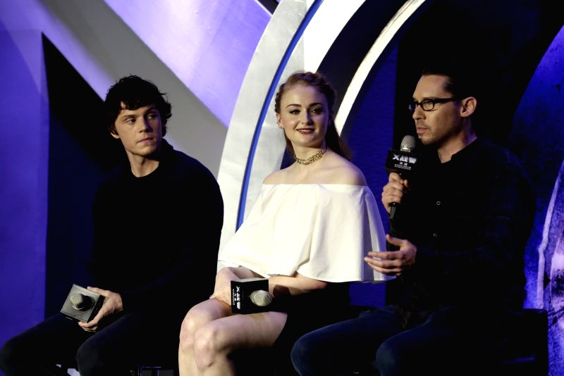 """BEIJING, May 18, 2016 - Director Bryan Singer (R), actor Evan Peters (L) and actress Sophie Turner attend a press conference for the film """"X-Men: Apocalypse"""" in Beijing, capital of China, ... - Evan Peters"""