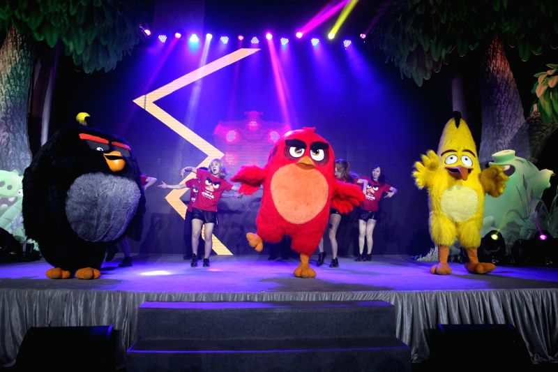 "BEIJING, May 18, 2016 - Guests dance with characters from the animated film ""The Angry Birds Movie"" during its premiere in Beijing, capital of China, May 17, 2016."