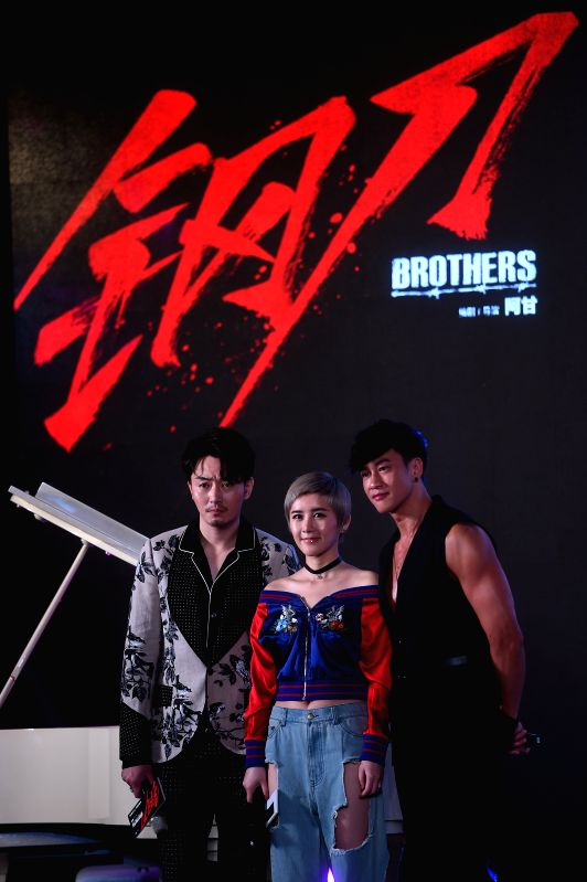 """BEIJING, May 18, 2016 - Movie star Li Xuedong (L), Xia Zitong (C) and Peter Ho attend the premiere of action movie """"Brothers"""" in Beijing, capital of China, May 18, 2016. The movie will be ..."""