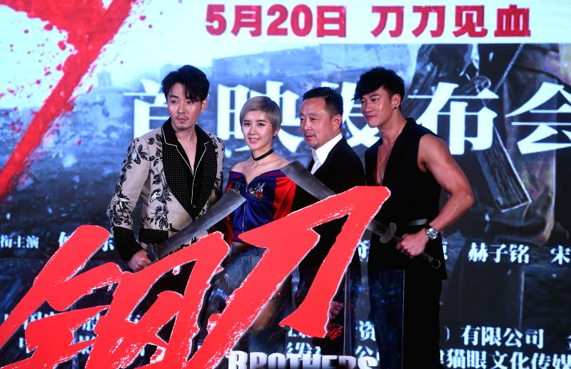 """BEIJING, May 18, 2016 - Movie star Li Xuedong, Xia Zitong, director A Gan (Liu Xiaoguang) and movie star Peter Ho (L-R) attend the premiere of action movie """"Brothers"""" in Beijing, capital of ... - A Gan"""
