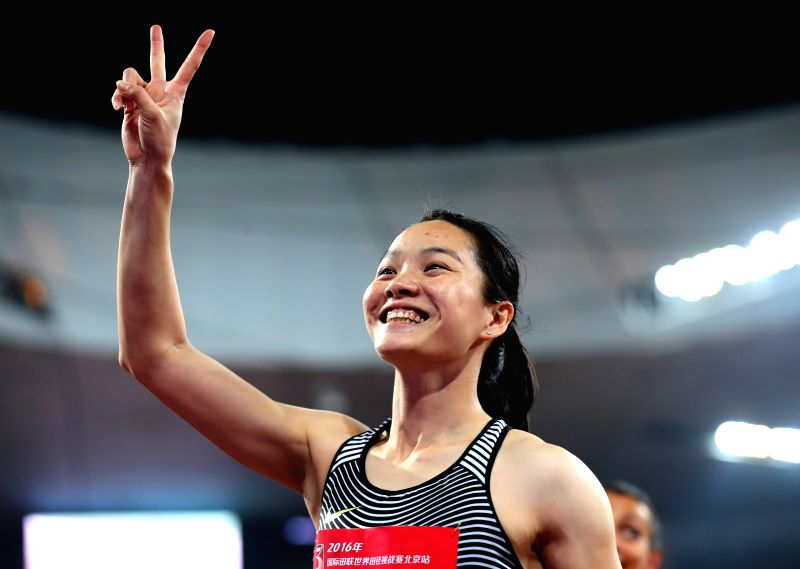 BEIJING, MAY 18, 2016 - Wei Yongli of China celebrates after the Women's 100m Final at 2016 IAAF World Challenge Beijing at National Stadium in Beijing, China, on May 18, 2016. Wei Yongli took the ...