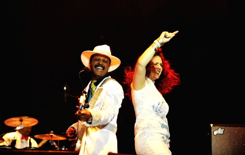 Larry Graham (L) of the American funk band Graham Central Station performs along with a fellow band member on the first day of the 2014 Midi Music Festival in ...