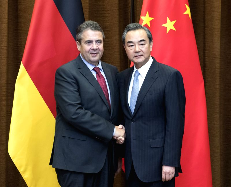 BEIJING, May 24, 2017 - Chinese Foreign Minister Wang Yi (R) holds talks with German Vice Chancellor and Foreign Minister Sigmar Gabriel, in Beijing, capital of China, May 24, 2017. - Wang Y