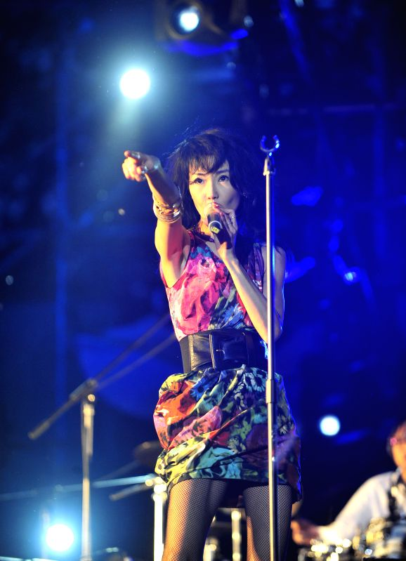 Hong Kong film star Maggie Cheung performs during the 2014 Strawberry Music Festival in Beijing, capital of China, May 3, 2014. The 3-day festival was held here from .