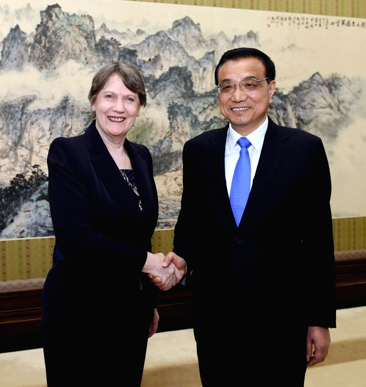 Chinese Premier Li Keqiang (R) meets with Helen Clark, under-secretary-general of the United Nations (UN) and administrator of the United Nations Development Program ...