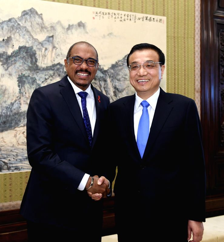 Chinese Premier Li Keqiang (R) meets with Michel Sidibe, under-secretary-general of the United Nations (UN) and executive director of UNAIDS, in Beijing, capital of ...