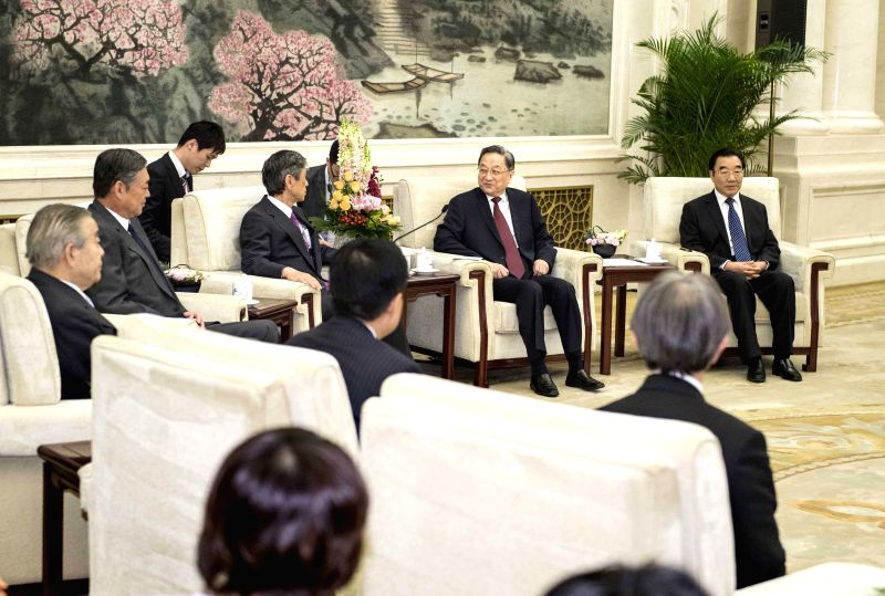 BEIJING, May 4, 2017 - Yu Zhengsheng, chairman of the National Committee of the Chinese People's Political Consultative Conference, meets with a delegation of Japan-China Friendship Parliamentarians' ...