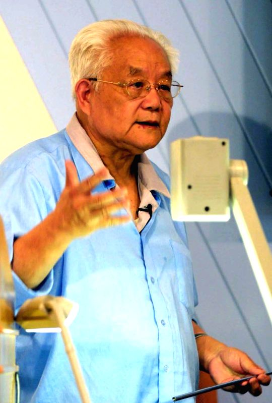 BEIJING, May 7, 2017 - File photo taken on Aug. 27, 2002 shows renowned Chinese mathematician Wu Wenjun giving a speech on mathematics history of China during the 2002 International Congress of ...