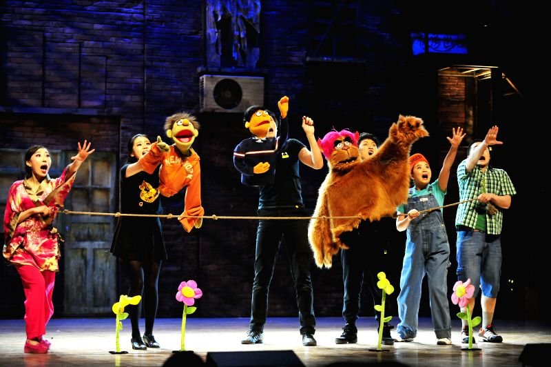 Actors perform during the Chinese version of American musical Avenue Q at the Haidian Opera in Beijing, capital of China, May 7, 2014. Avenue Q is conceived by Robert
