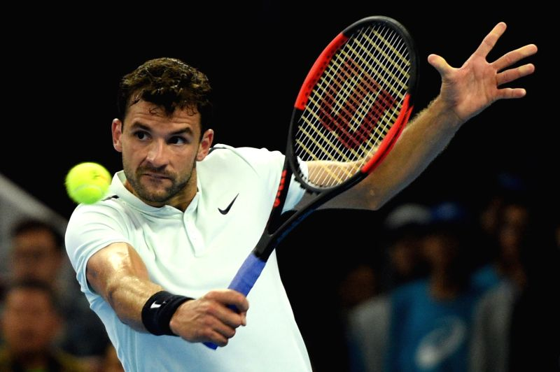 BEIJING, Oct. 7, 2017 - Grigor Dimitrov of Bulgaria returns the ball during the men's singles semifinal match against Rafael Nadal of Spain at the China Open tennis tournament in Beijing on Oct. 7, ...