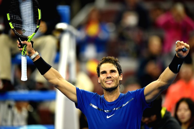 BEIJING, Oct. 7, 2017 - Rafael Nadal of Spain celebrates after winning the men's singles semifinal match against Grigor Dimitrov of Bulgaria at the China Open tennis tournament in Beijing on Oct. 7, ...