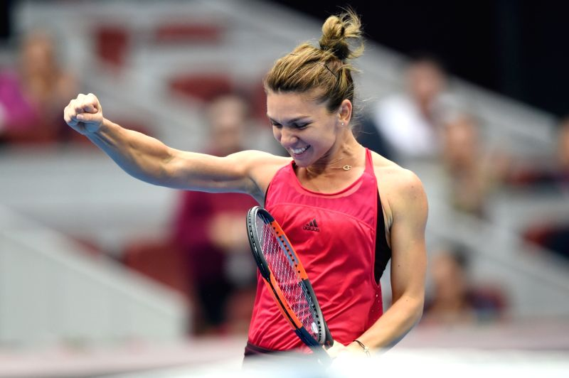 BEIJING, Oct. 7, 2017 - Simona Halep of Romania celebrates after winning the women's singles semifinal match against Jelena Ostapenko of Latvia at the China Open tennis tournament in Beijing on Oct. ...