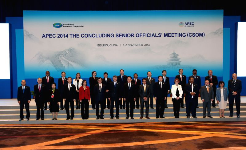 Officials attend the Asia-Pacific Economic Cooperation (APEC) 2014