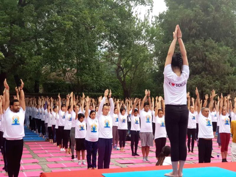 Beijing: People practice yoga asanas -postures- on International Yoga Day 2019 in Beijing, China on June 21, 2019. (Photo: IANS/MEA)