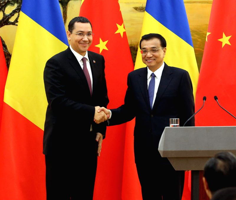 Chinese Premier Li Keqiang (R) and Romanian Prime Minister Victor Ponta attend a joint press conference after their talks in Beijing, capital of China, Sept. 1, ...