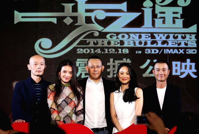 """Director Jiang Wen (C) and leading casts of the movie """"Gone with the Bullets"""" attend the press conference in Beijing, capital of China, Sept. 1, 2014. The"""