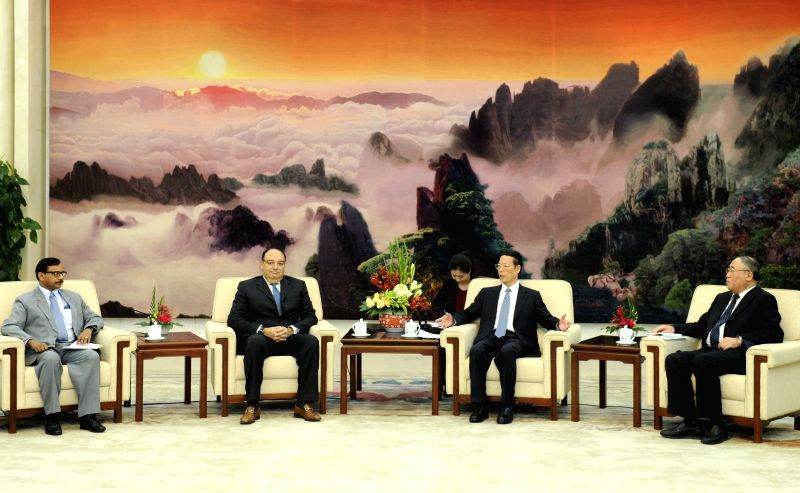 Chinese Vice Premier Zhang Gaoli (2nd R) meets with participants for the meeting of Like Minded Developing Countries (LMDC) group on climate change, in Beijing, ...