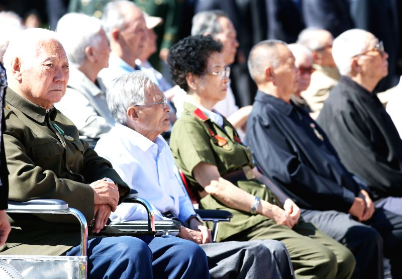 Veterans attend a ceremony to mark the 69th anniversary of the Victory Day in the Anti-Japanese War at the Museum of the War of the Chinese People's Resistance ...