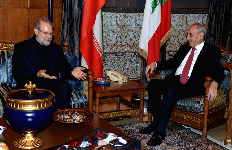 Iranian Parliament Speaker Ali Larijani (L) meets with the Speaker of the Lebanese Parliament Nabih Berri in Beirut, Lebanon, Dec. 22, 2014. Larijani affirmed his ... - Ali Larijani