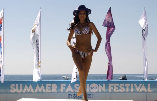 A model presents the latest summer collection from Diamony during Lebanon Summer Fashion Festival held in the pool area in southern Beirut on June 15, 2014.