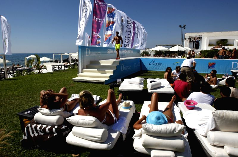 A model presents the latest summer collection from Diamony during Lebanon Summer Fashion Festival held in the pool area in southern Beirut on June 15, 2014. (Photo: .