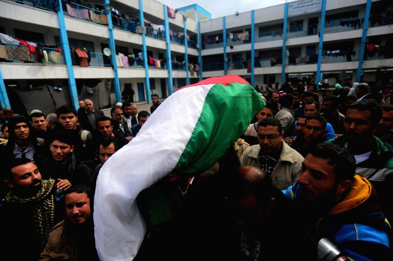 Mourners carry the body of 16-month-old Palestinian Izedin al-Kafarna at his funeral in the northern Gaza Strip town of Beit Hanun, on Feb. 17, 2015. ...