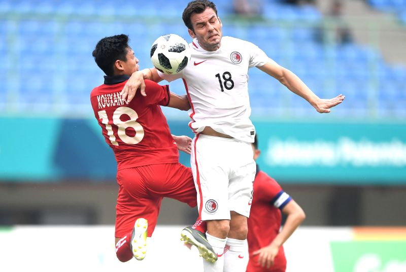 BEKASI, Aug. 10, 2018 - Jorge Tarres Paramo (R) of Hong Kong of China vies with Sihalath Xouxana of Laos during the Men's Football Group A match at the 18th Asian Games at Patriot Stadium in Bekasi, ...