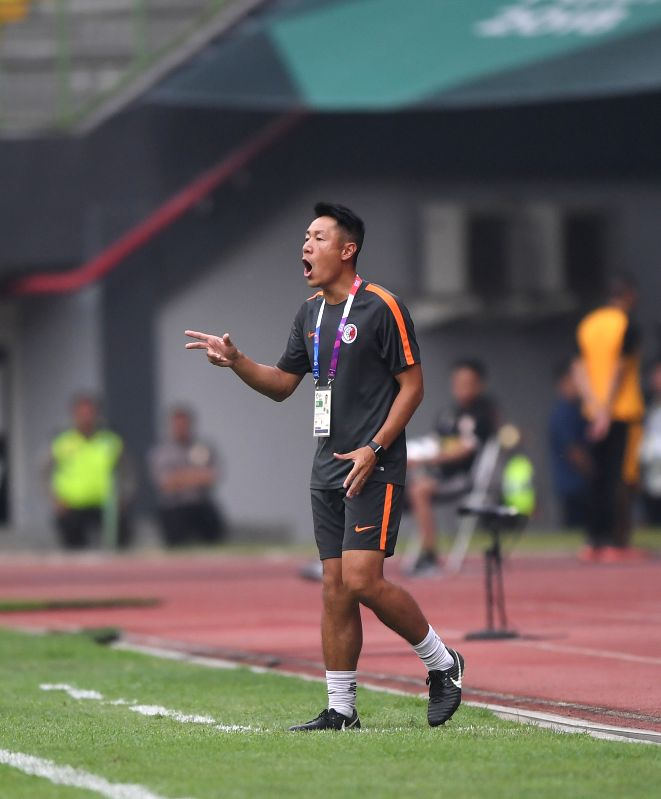 BEKASI, Aug. 10, 2018 - Kwok Kar Lok Kenneth, head coach of Hong Kong of China, reacts during the Men's Football Group A match between Kwok Kar Lok Kenneth and Laos at the 18th Asian Games at Patriot ...