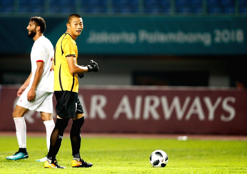 BEKASI, Aug. 10, 2018 - Pan Wenchieh (R), goalkeeper of Chinese Taipei reacts during the Men's Football Group A match between Chinese Taipei and Palestine at the 18th Asian Games at Patriot Stadium ...