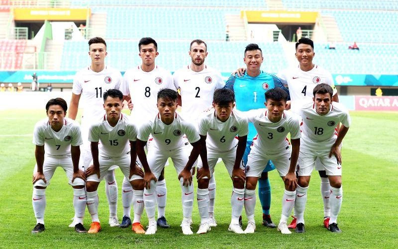 BEKASI, Aug. 10, 2018 - Players of Hong Kong of China line up for photos before the Men's Football Group A match between Hong Kong of China and Laos at the 18th Asian Games at Patriot Stadium in ...