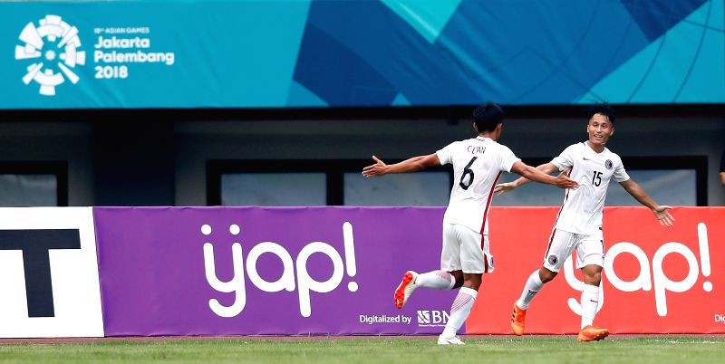 BEKASI, Aug. 10, 2018 - Tan Chun Lok (L) of Hong Kong of China celebrates with his teammate Yu Pui Hong after scoring during the Men's Football Group A match between Hong Kong of China and Laos at ...