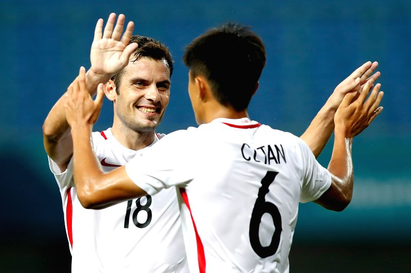 BEKASI, Aug. 10, 2018 - Tan Chun Lok (R) of Hong Kong of China celebrates with his teammate Jorge Tarres Paramo after scoring during the Men's Football Group A match between Hong Kong of China and ...