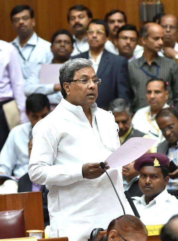 Karnataka Chief Minister Siddaramaiah speaks at Karnataka Legislative Assembly during the winter session of the house in Belagavi on Dec 11, 2014. - Siddaramaiah