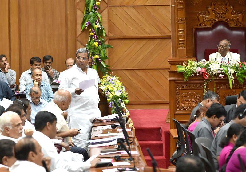 Karnataka Chief Minister Siddaramaiah speaks at Karnataka Legislative Assembly during the winter session of the house in Belagavi on Dec 11, 2014. - Siddaramaiah