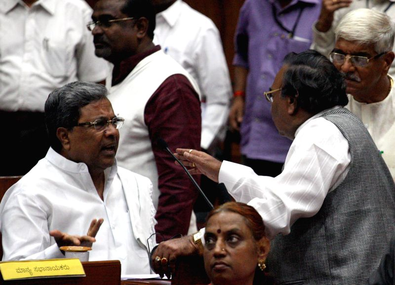 Karnataka Chief Minister Siddaramaiah argues with BJP legislatorK. S. Eshwarappa at Karnataka Legislative Assembly during the winter session of the house in Belagavi on Dec 11, 2014. - Siddaramaiah