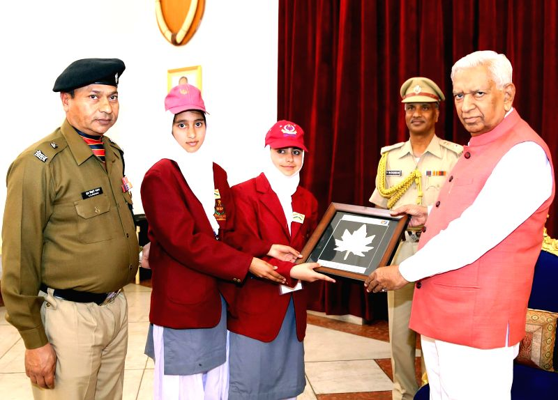 Students from Jammu and Kashmir meet Karnataka Governor Vajubhai Rudabhai Vala at Rajbhavan, in Belagavi on Dec 11, 2014.