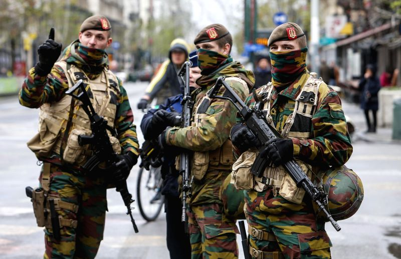 Belgian soldiers patrol in central Brussels, capital of Belgium, on Nov. 22, 2015. Belgian Prime Minister Charles Michel confirmed on Sunday evening that the level ... - Charles Michel