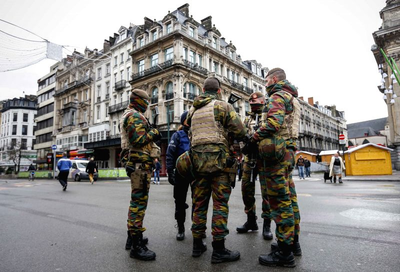 Belgian soldiers patrol in central Brussels, capital of Belgium, on Nov. 22, 2015. The terror threat level in the Brussels region was increased to ... - Jan Jambon