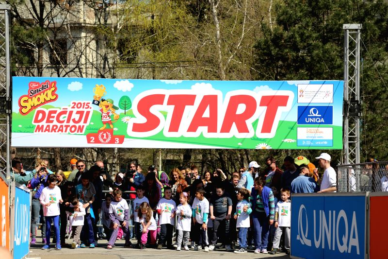 Children take positions behind the starting line of the Children Marathon in Belgrade Zoo, Serbia, on April 11, 2015.