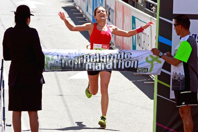 BELGRADE, April 21, 2018 - Serbia's Nora Trklja (C) celebrates as she passes the finish line at the 31th Belgrade marathon in Belgrade, Serbia on April 21, 2018.