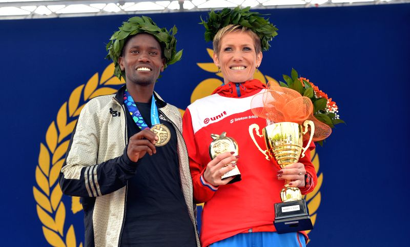 BELGRADE, April 22, 2017 - Gold medalists Kenya's Stephen Kipngetich Katam (L) and Serbia's Olivera Jevtic pose for photo at the 30th Belgrade marathon in Belgrade, Serbia on April 22, 2017.