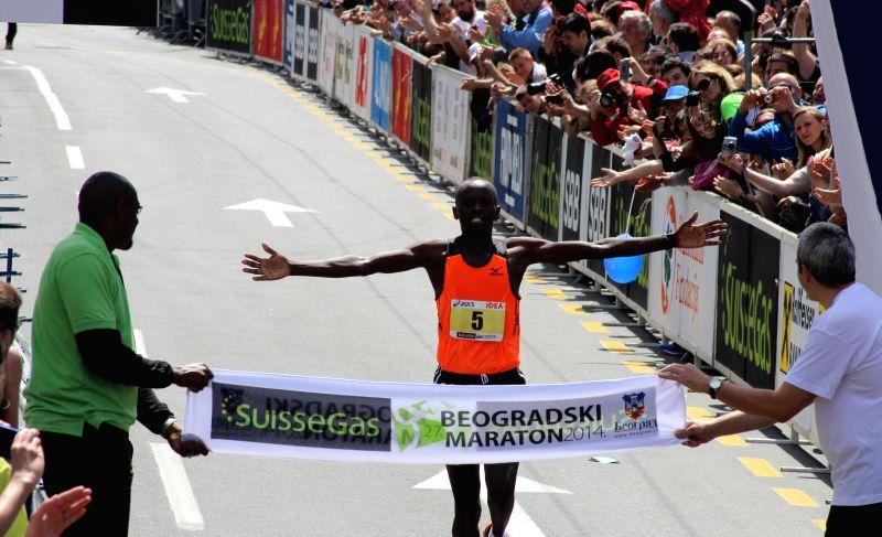 Bernard Kipkorir Talam of Kenya crosses the finish line to win the men's event at the 27th Belgrade Marathon on April 27, 2014, in Belgrade, capital of Serbia.
