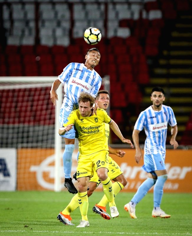 BELGRADE , Aug. 10, 2018 - Spartak's Noboru Shimura (Top) vies with Brondby's Simon Tibbling during UEFA Europa League third qualifying round football match between Spartak Subotica and Brondby in ...