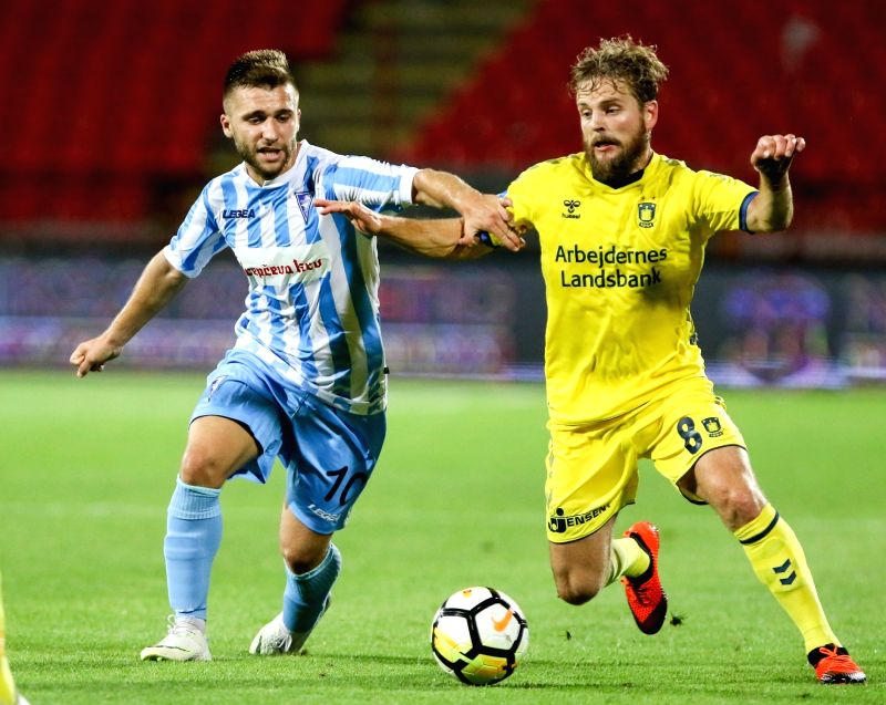 BELGRADE , Aug. 10, 2018 - Spartak's Stefan Milosevic (L) vies with Brondby's Kasper Fisker during UEFA Europa League third qualifying round football match between Spartak Subotica and Brondby in ...