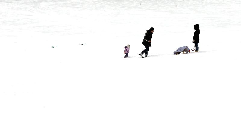 BELGRADE, Jan. 11, 2017 - A family enjoys snow fun on a cold winter day in Belgrade, Serbia, on Jan. 11, 2017. Due to low temperatures and long-lasting heavy snowfall, an emergency situation has been ...