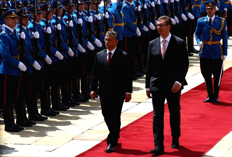 Serbian Prime Minster Aleksandar Vucic (front R) and Hungarian Prime Minister Viktor Orban (front L) inspect the guard of honor in Belgrade, Serbia, July 1, 2014.